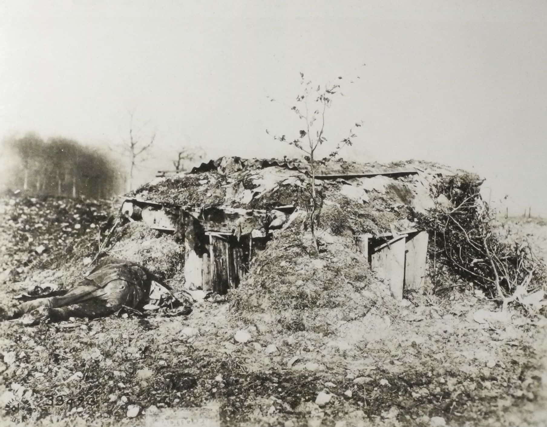 German machine gun nest at Molleville Farm near Etraye.  The body of an American soldier blocks one of the firing ports. (AHEC)