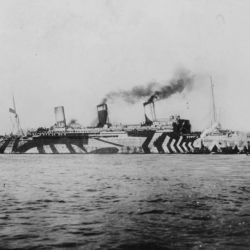 "USS Leviathan, formerly the Hamburg-Amerika liner Vaterland, in ""dazzle"" camouflage. The Leviathan carried 96,804 American troops, among them the headquarters and one brigade of the 79th Division, to France. (U.S. Naval Historical Center)"